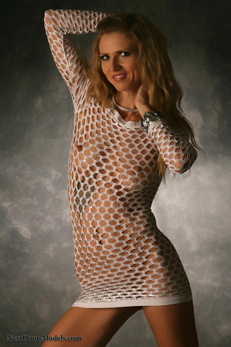 Blonde model in white fishnet dress - Jewell - 1