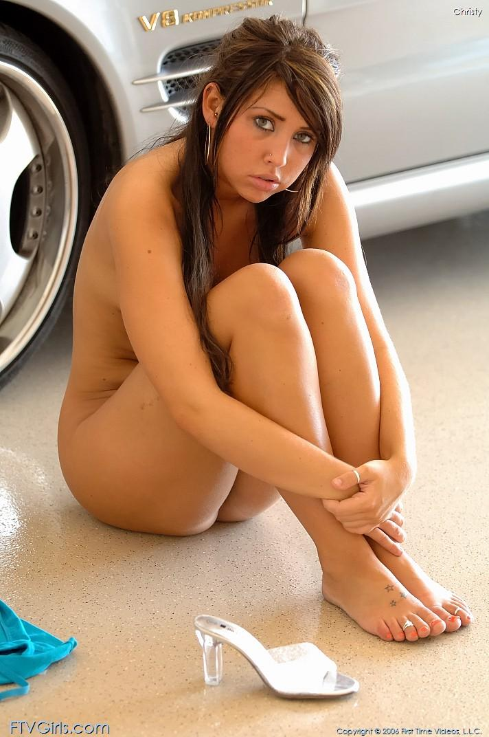 Busty Christy is posing naked next to a car - 5