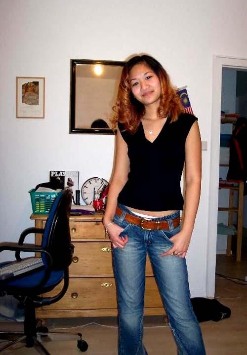 Redhead Asian is stripping her clothes (5 pics) | Erooups.com