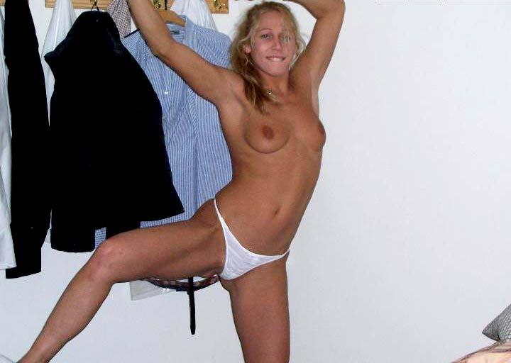 Spunky blonde is removing her underwear - 2