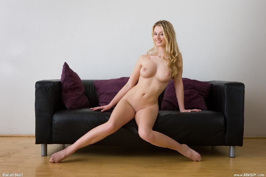 Splendid blonde is posing on sofa - Carisha - 5