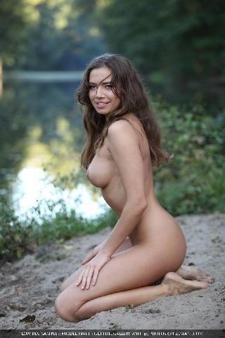 Naked and magic girl near the lake - Traci