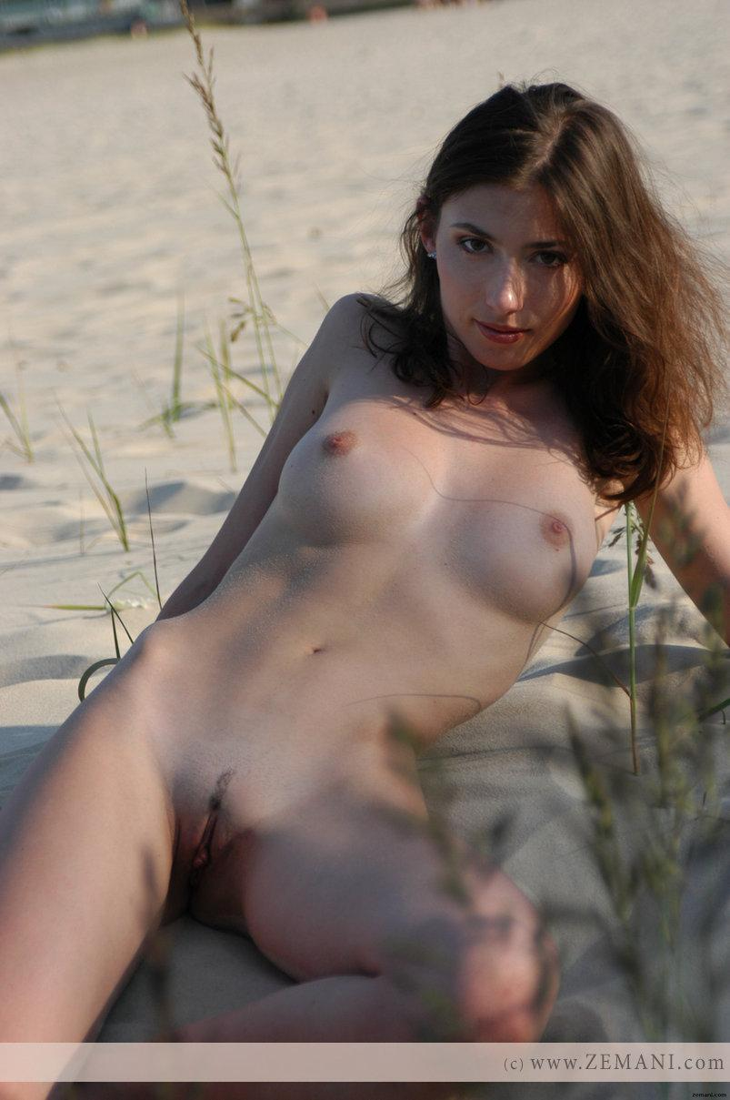 Teen Katya with a fantastic body poses nude on the sand - 12