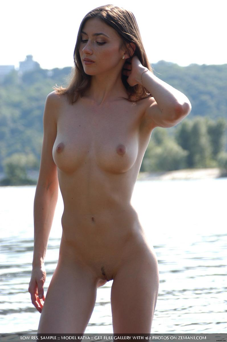 Teen Katya with a fantastic body poses nude on the sand - 13