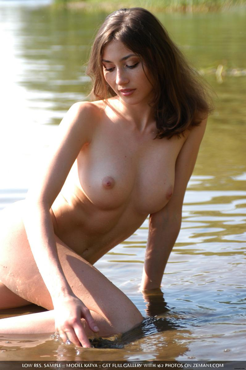 Teen Katya with a fantastic body poses nude on the sand - 16