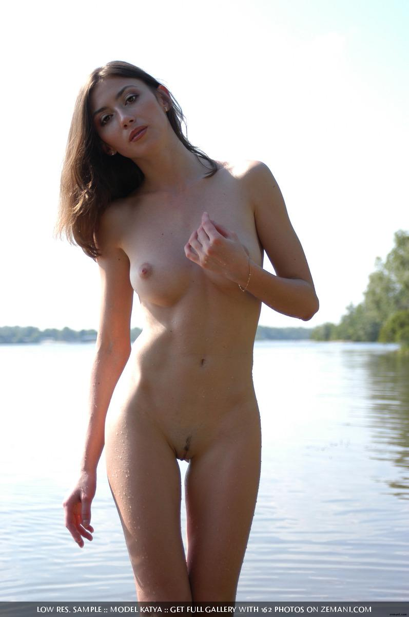 Teen Katya with a fantastic body poses nude on the sand - 18