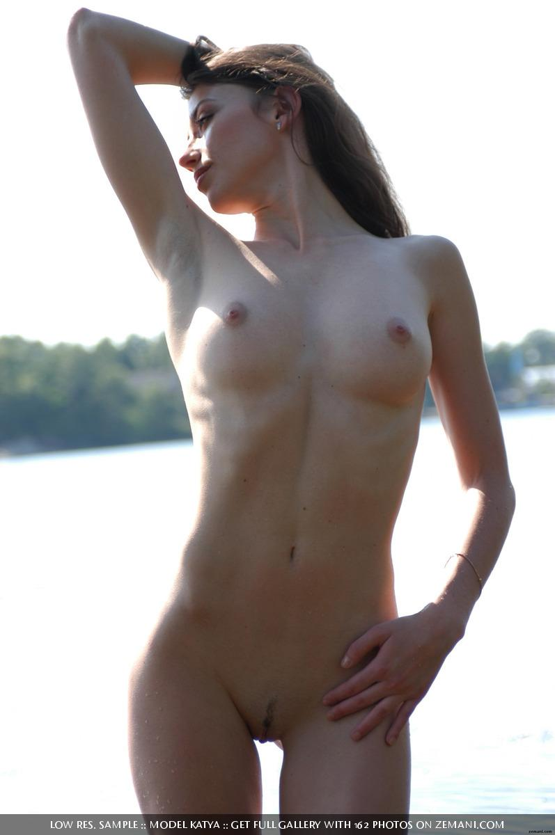 Teen Katya with a fantastic body poses nude on the sand - 19