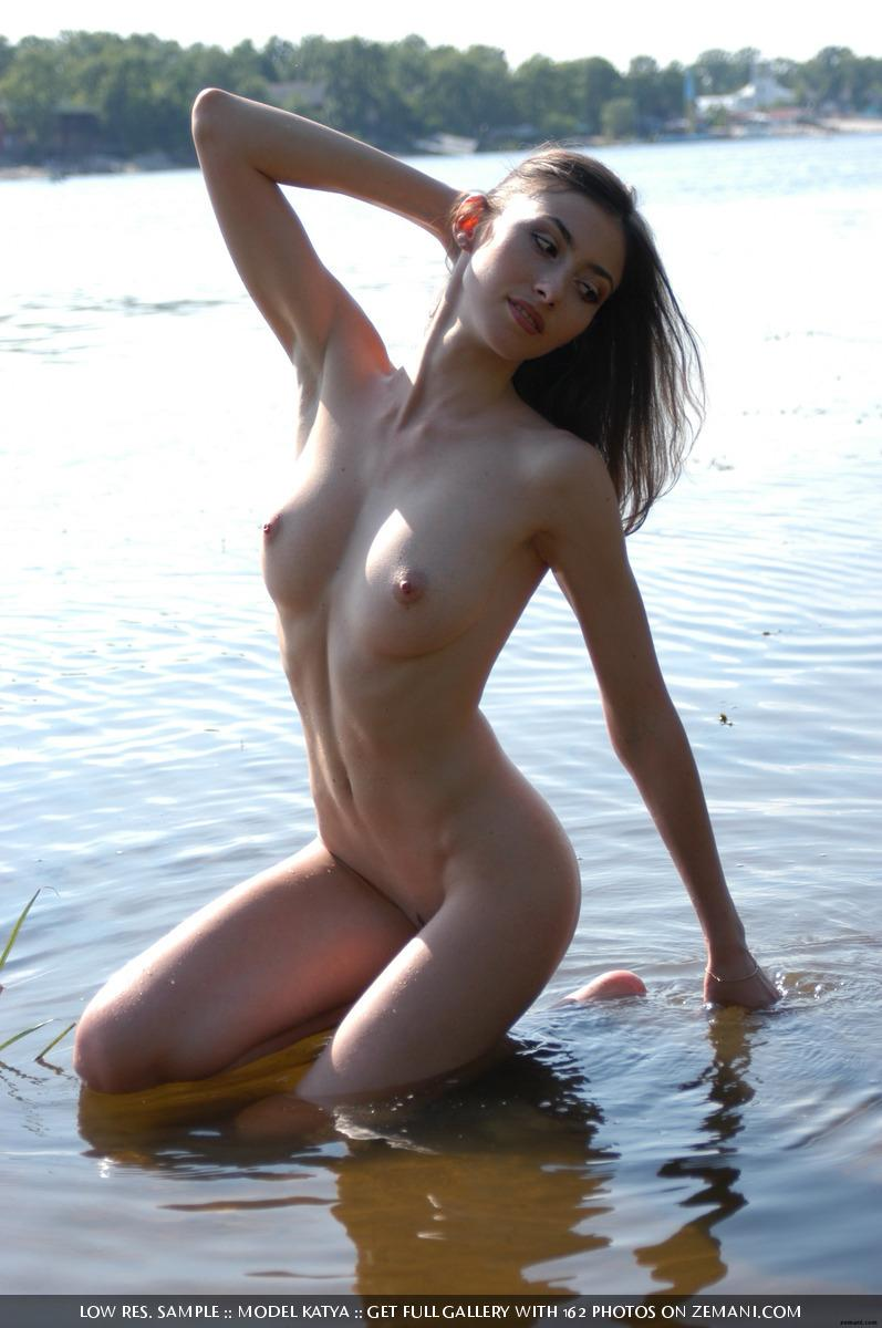 Teen Katya with a fantastic body poses nude on the sand - 20