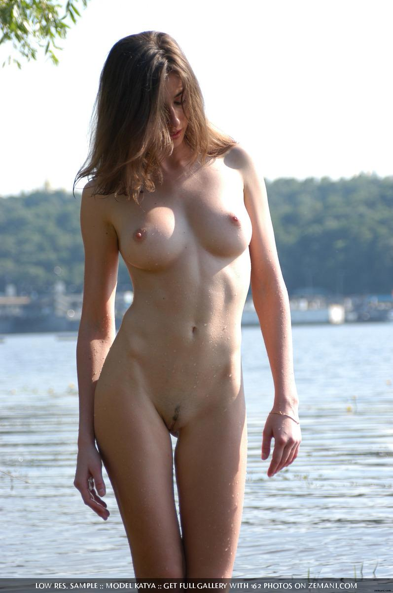 Teen Katya with a fantastic body poses nude on the sand - 21