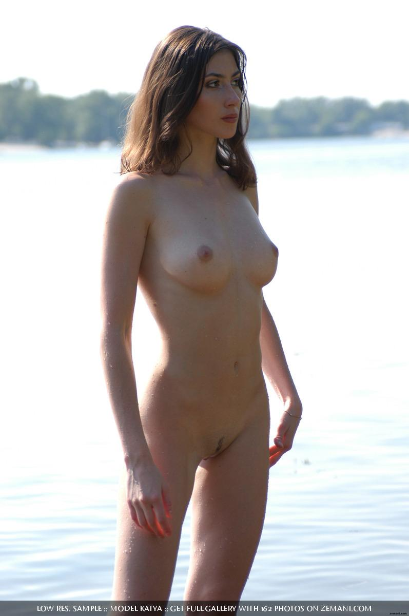 Teen Katya with a fantastic body poses nude on the sand - 23