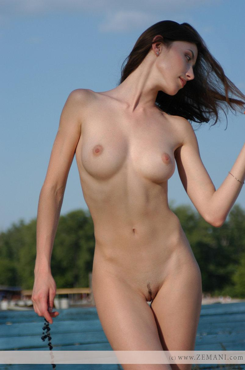 Teen Katya with a fantastic body poses nude on the sand - 6