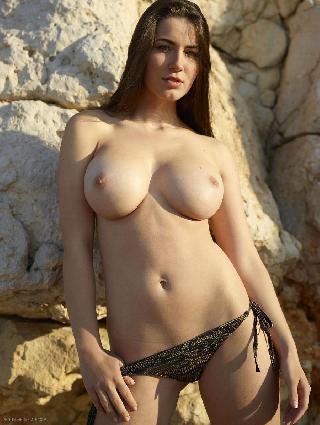 Stunning brunette beside rock wall - Yara. Part 2