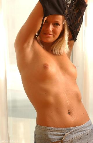 Cute blonde and her undressing - Dagmara