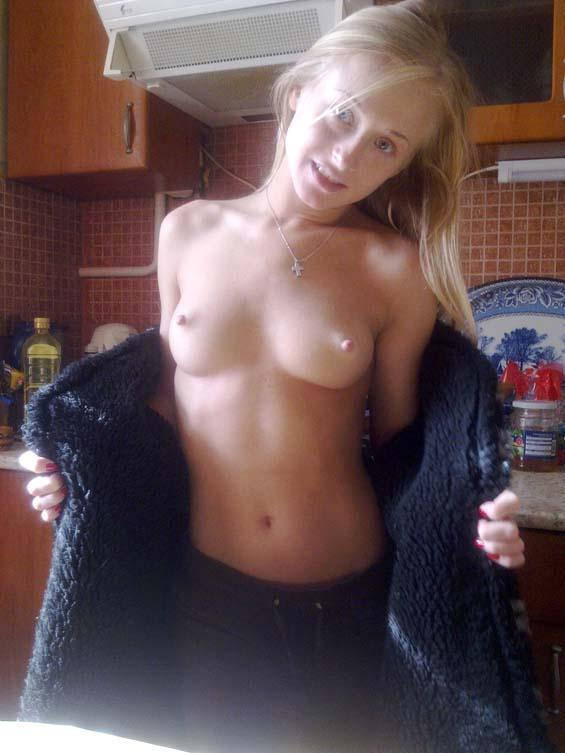 Attractive blonde is showing her goods - 2