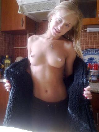Attractive blonde is showing her goods