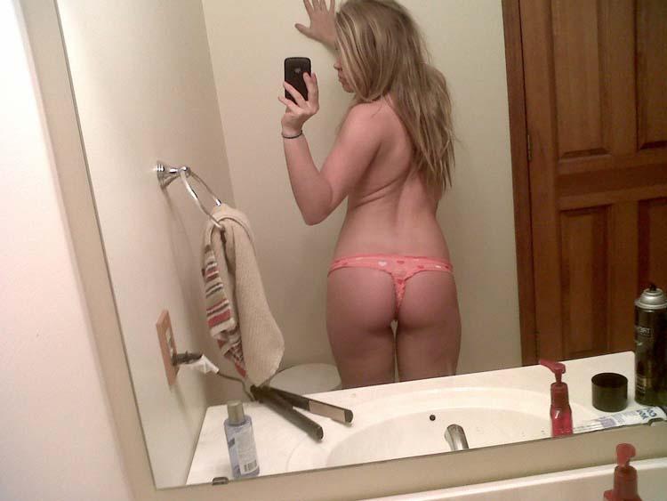 Blonde masturbates in bed - 1
