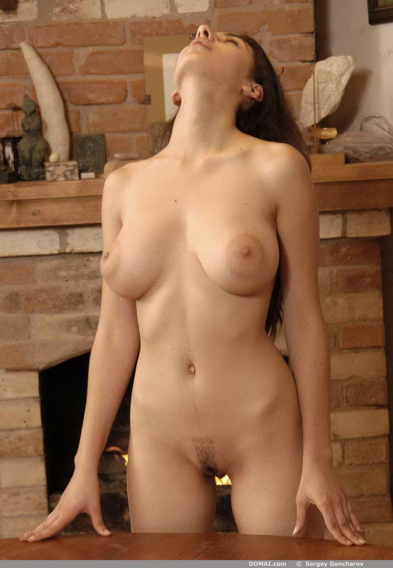 Naked girl beside fireside - Angela - 10