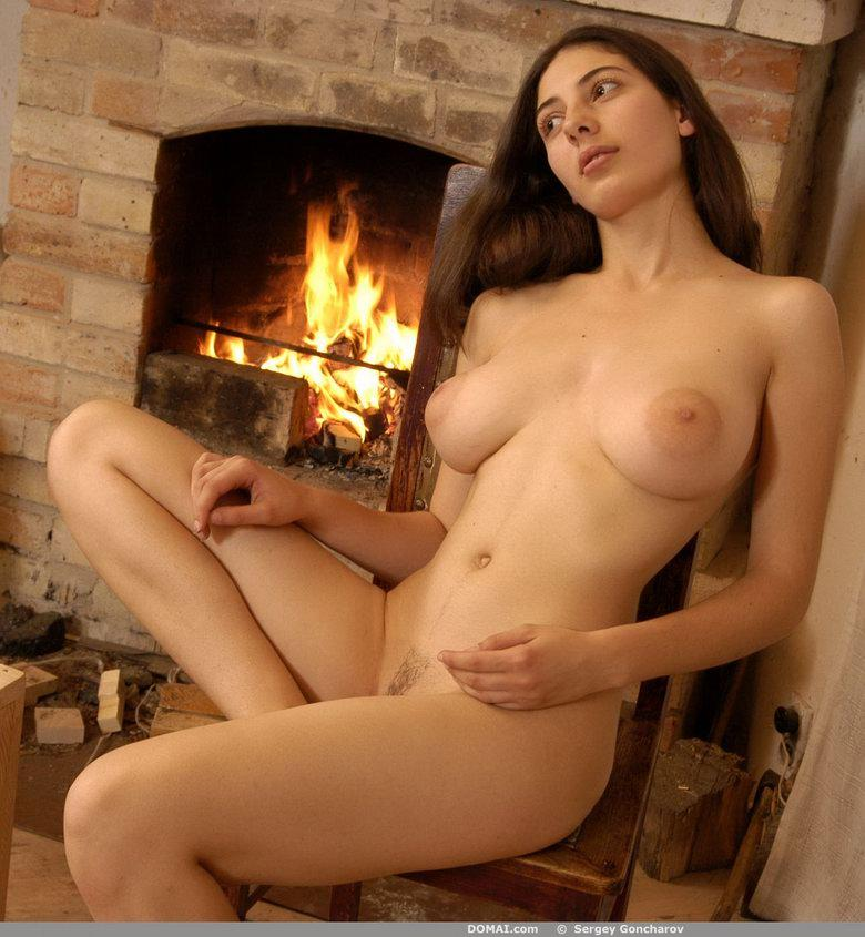 Naked girl beside fireside - Angela - 17