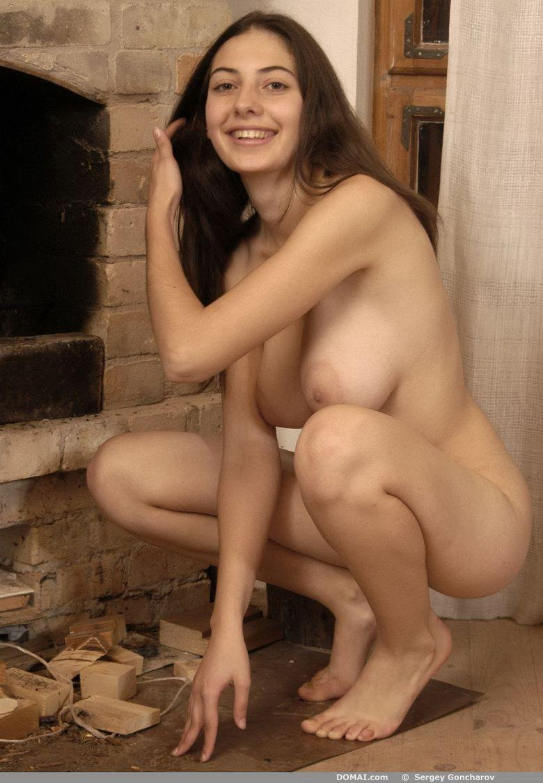Naked girl beside fireside - Angela - 3