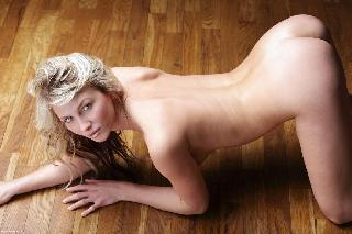 Naked blonde in tempting poses - Nicole