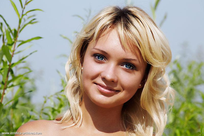 Blue-eyed blonde is posing outdoor - Lada - 7