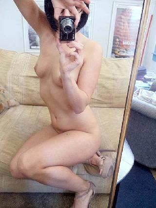 Naked girl is showing pretty pussy
