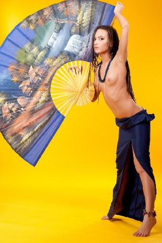 Long-haired model in yellow studio - Zara Z