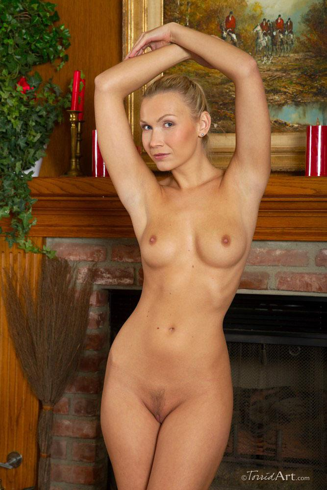 Blonde beside fireplace - Michaela - 13