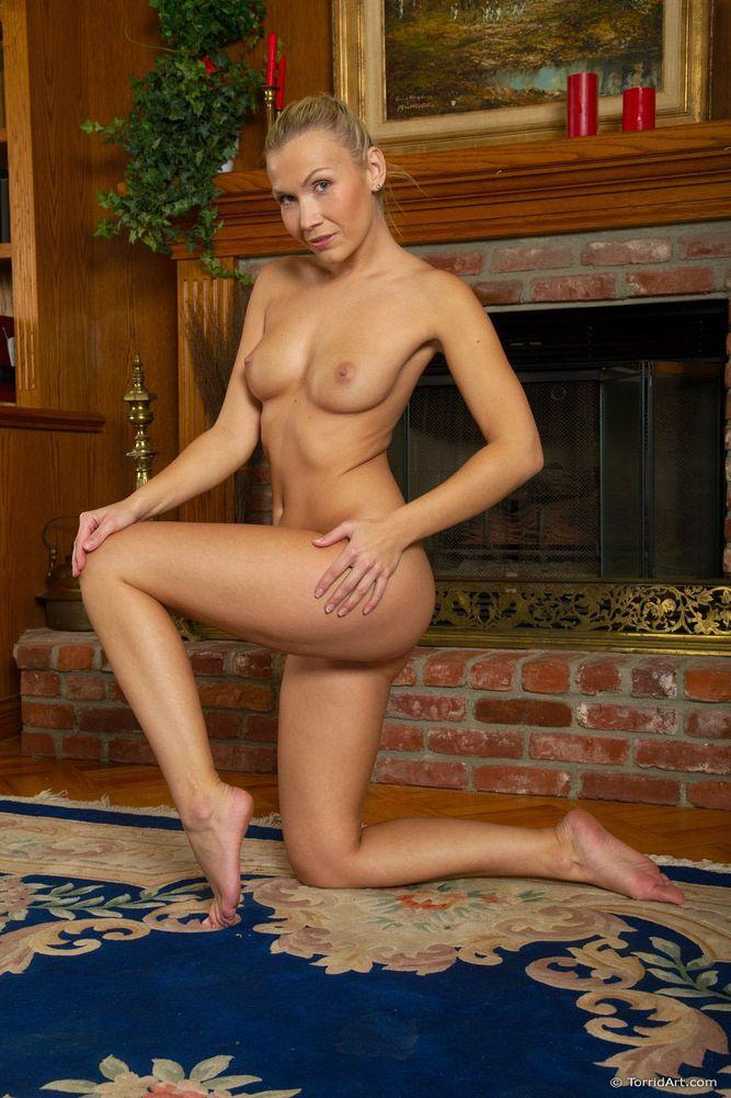 Blonde beside fireplace - Michaela - 14