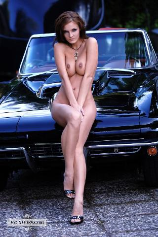 Hot and naked woman is posing on car hood - Linda L