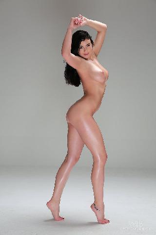 Dark-haired model is posing in studio - Lucy
