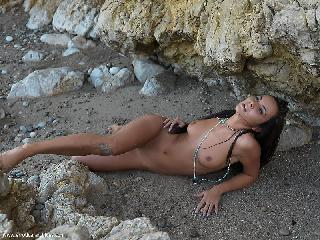Naked Nataly is posing on rocks