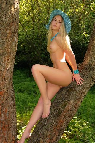 Wonderful blonde girl on meadow - Olga Q