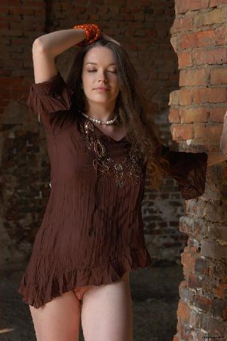 Long-haired girl is posing in ruins - Polya