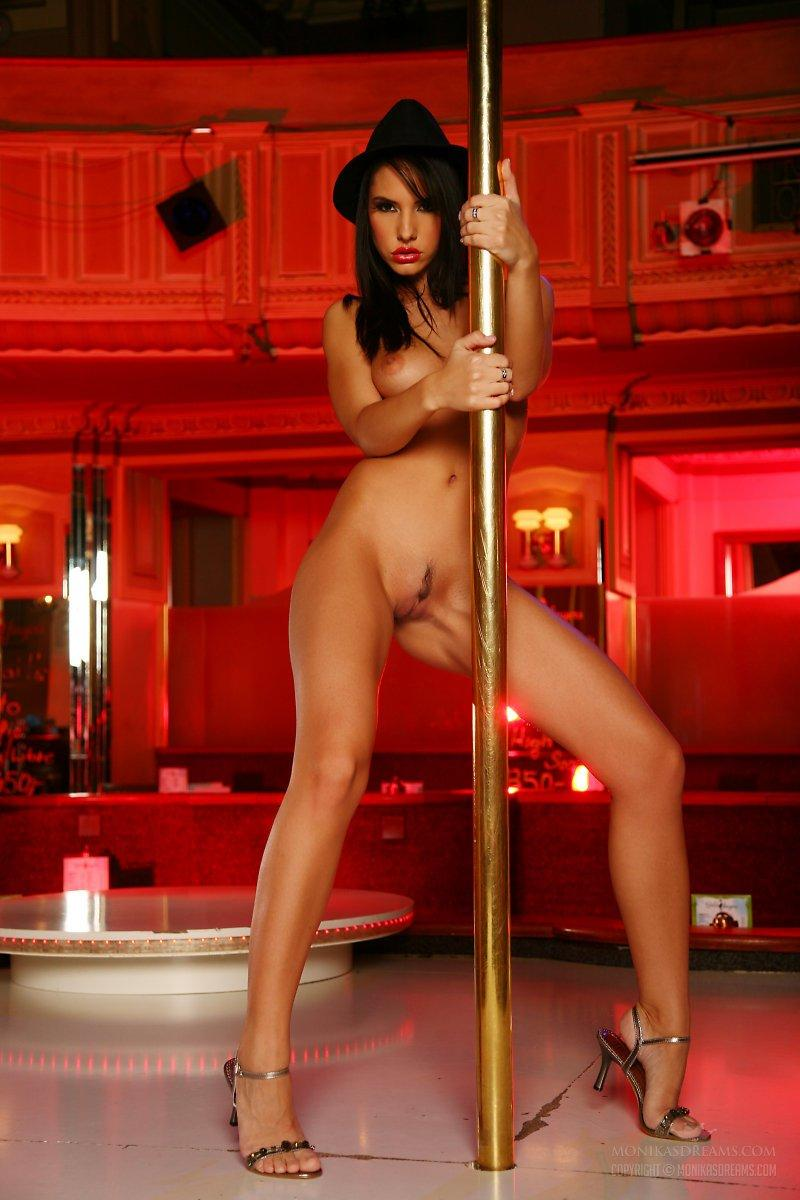 Naked pole dancer dancing