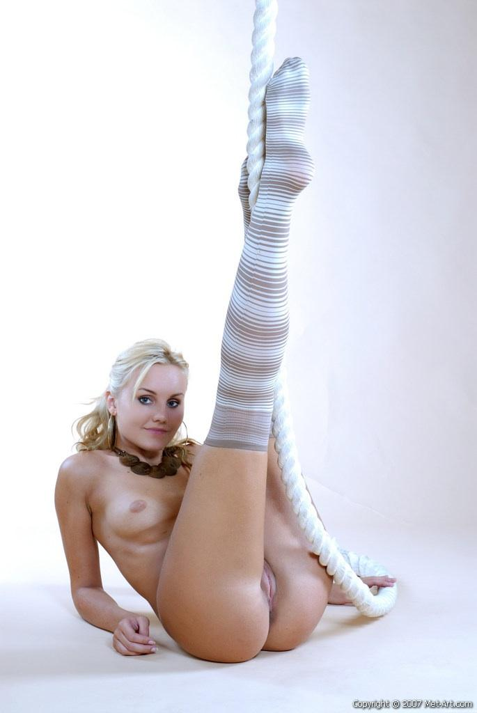 Magnificent blonde girl is posing in high socks - Tess A - 6