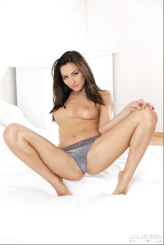 Fantastic chick alone on bed - Michaela Isizzu