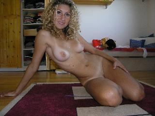 Naked blonde girl is posing on the floor - Tanya