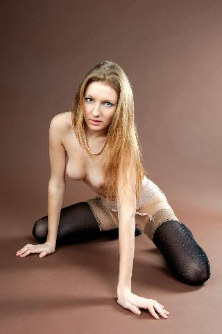 Long-haired model in black stockings - Odette A