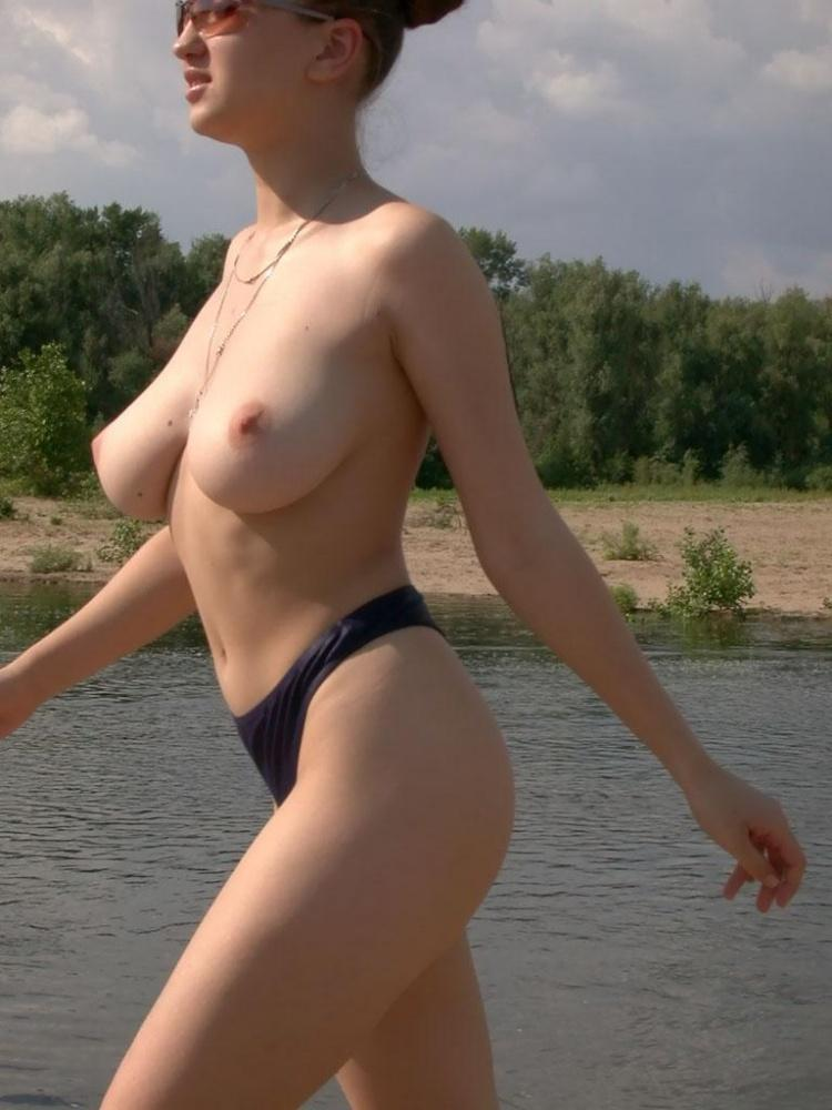 Busty amateur is posing on the beach - 1