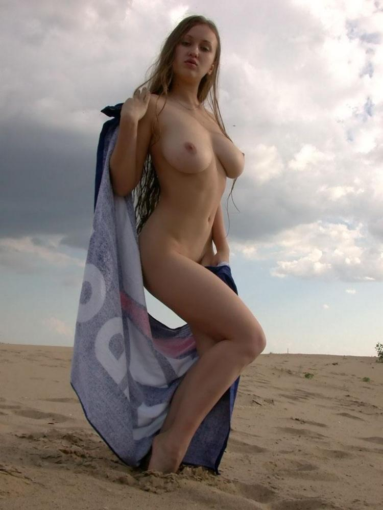 Busty amateur is posing on the beach - 10