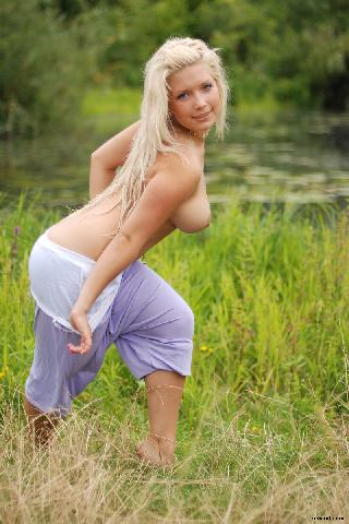 Stunning blonde is posing in nature - Melica C
