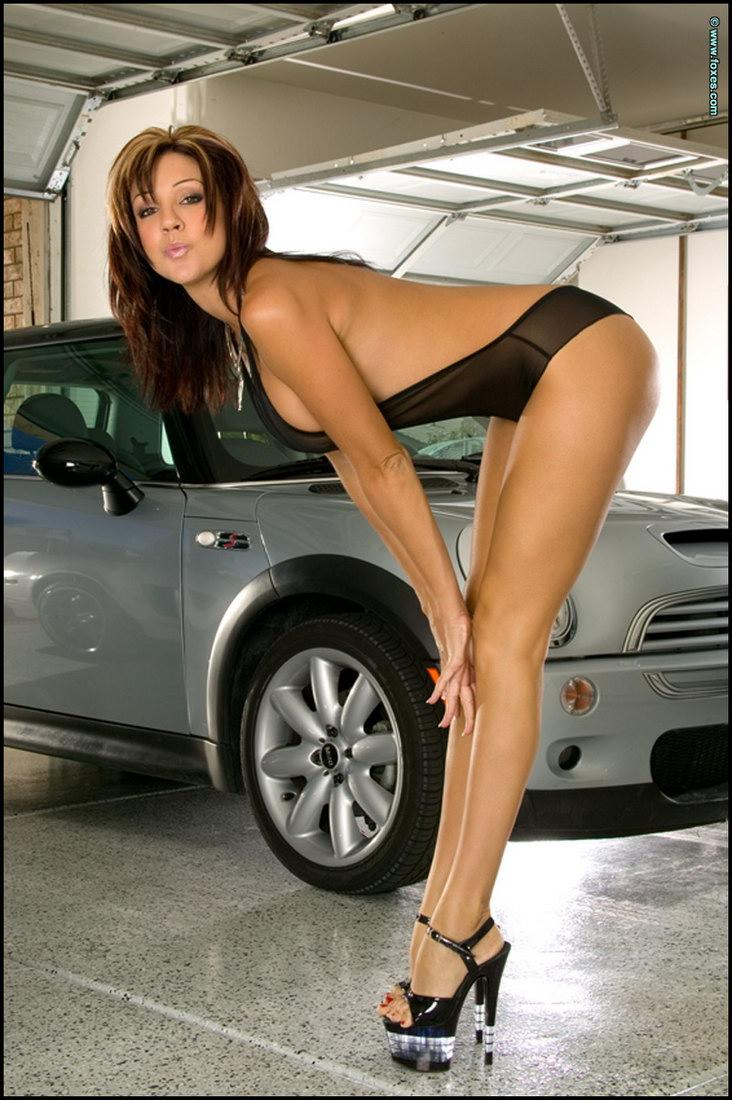naked women beside cars