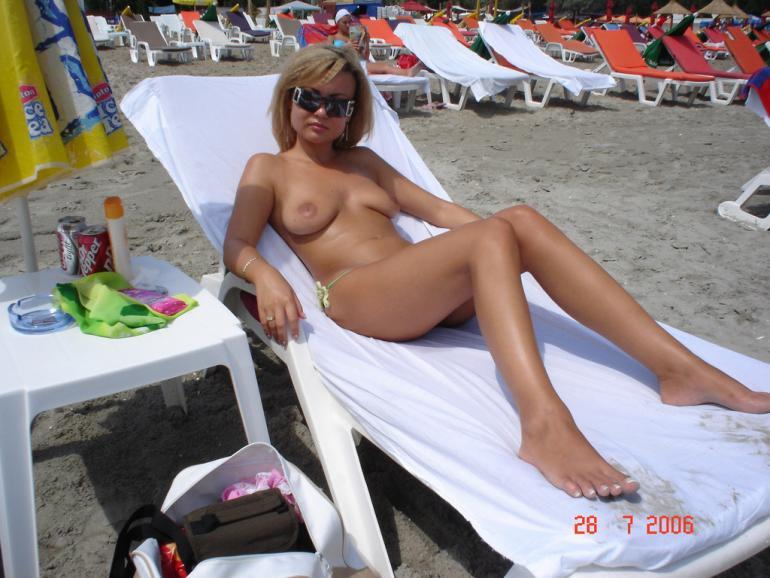 Blonde amateur topless on the public beach - 7