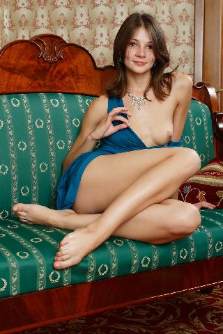Young and pretty girl is posing on sofa - Alina F