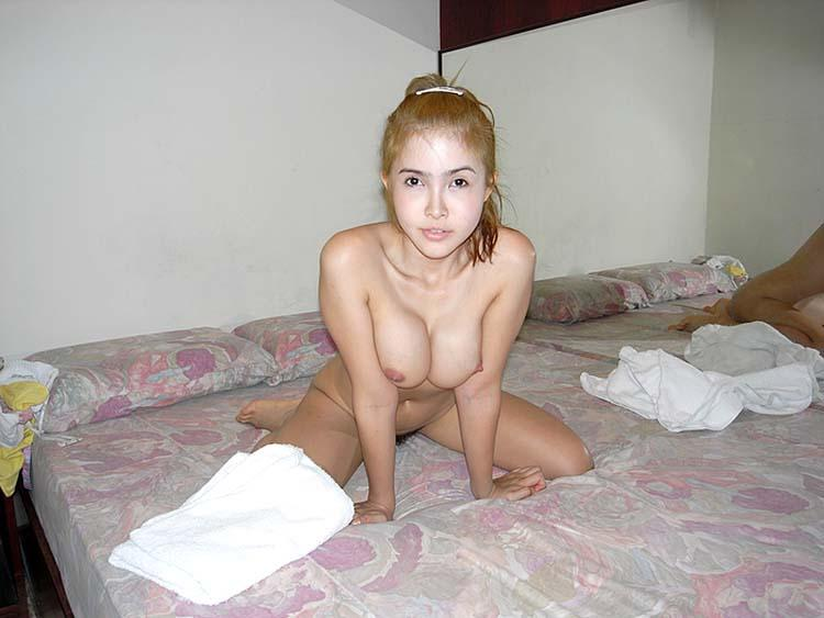Blond shows tits in hotel room