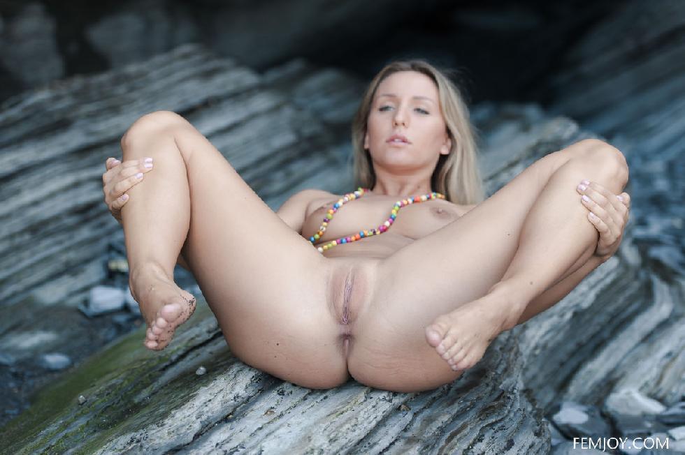 Naked blonde bitch posing