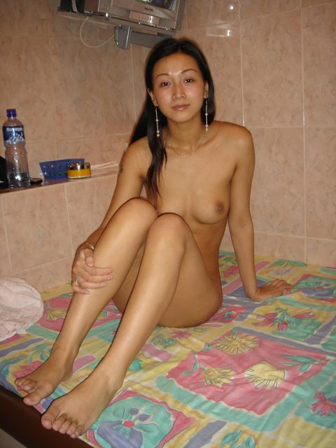 Tiny naked Asian is taking a shower - 1
