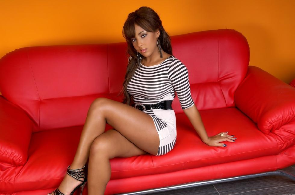 Wonderful ebony is posing on red sofa - Kayla Louise - 1