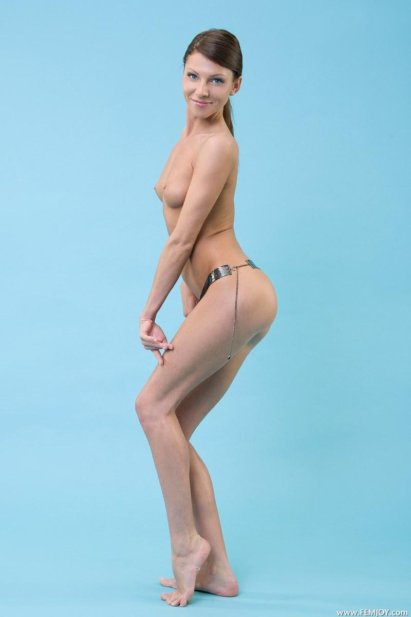 Bekki is posing in a studio and wearing only a belt - 3